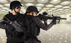 Defense against terrorism, two soldiers at an airport Stock Photos
