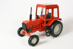 Scale metal collection model of an agricultural wheeled tractor on a white back Stock Photos