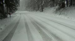 Snowy road flyover Stock Footage