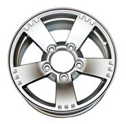 An isolated modern aluminum alloy wheel on a white background - stock photo