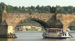 Cruise ship under the Charles Bridge Stock Footage