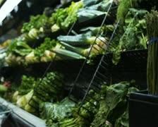 Produce aisle at a grocery store Stock Footage