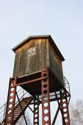 Observation tower for wild animals monitoring against a blue sky in the late - stock photo