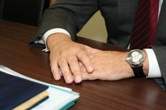 Hands of businessman giving an interview being recorded by a digital dictapho Stock Photos