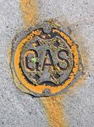 Vintage yellow gas manhole, energy details Stock Photos