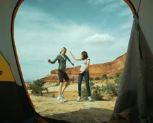 Two woman dancing on a campout Stock Footage