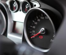 Car dashboard : an illuminated car dashboard in red and black Stock Photos