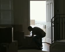 Man hurting back while lifting box Stock Footage