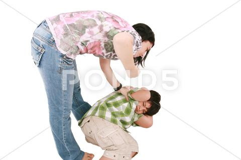 Stock photo of woman hitting a son who cringes, isolated on white background