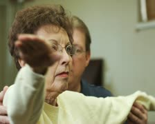 Physical therapist and a senior patient Stock Footage