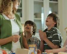 Mother stressed out by her children Stock Footage