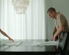 Couple spreading out a tablecloth Stock Footage