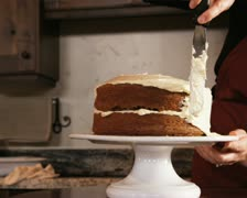 Woman frosting a cake Stock Footage