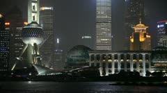 The stunning architecture of Pudong, Shanghai at night - stock footage