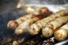 Fried sausages on the grill Stock Photos