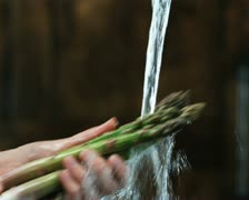 Hands washing asparagus Stock Footage