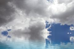 clam sea. a sky of clouds reflected in a water surface. - stock illustration
