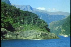 Milford Sound, New Zealand, POV wide shot, round spit of land, mountains Stock Footage