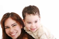 Joyful toddler on back of his mother Stock Photos