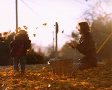 Mother and daughter get in leaf fight and throw leaves at eachother Stock Footage