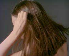 Close up portrait of a young brunette woman who pulls her hair back and smiles Stock Footage