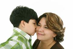 Little boy kiss his mother on a white background Stock Photos