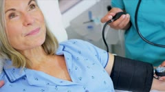 Hospital Doctor Checking Patient Blood Pressure Stock Footage