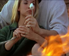 Medium two shot of a young caucasian couple out camping as they hold each other Stock Footage