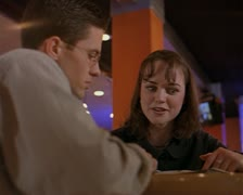 Medium over the shoulder shot of a young caucasian couple hanging out in a cafe Stock Footage