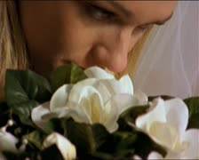 Close up portrait of a young blonde bride in her white wedding dress as she Stock Footage