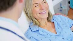 Senior Patient Treatment by Hospital Staff Stock Footage