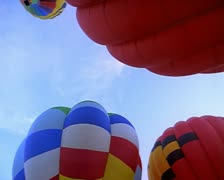 Wide shot as several hot air balloons prepare to take off Stock Footage