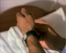 Close up shot of a syringe and needle as a nurse prepares to give a shot Stock Footage
