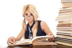 schoolgirl reading book - stock photo