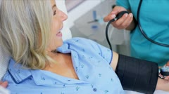 Medical Staff Taking Patient Blood Pressure Stock Footage