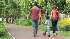 Asian Family Leaving Park After A Walk Stock Footage