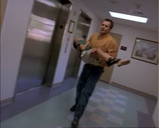 Hand held shot of a concerned caucasian father running into the hospital Stock Footage