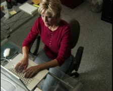 High angle medium shot of a blonde woman at her desk as her young daughter comes Stock Footage