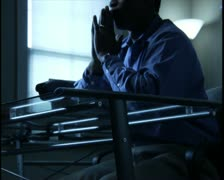 medium shot of a man in his home office appearing frustrated and stressed - stock footage