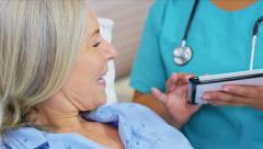 Wireless Tablet Recording Patient Treatment Plan - stock footage