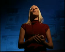 Medium shot of a young business woman as she talks in front of a video Stock Footage