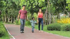 Asian Family Enjoying A Walk In The Park Stock Footage