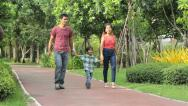 Stock Video Footage of Asian Family Enjoying A Walk In The Park