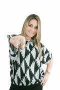 portrait of attractive smile laugh teenage girl, pointing her finger - stock photo
