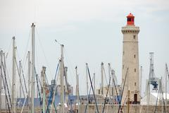 Lighthouse and boat mast Stock Photos