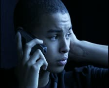 Close up shot of a teenage male at night as he chats on his cell phone Stock Footage