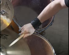 handheld close up of a young man as he wildly plays his drum set - stock footage