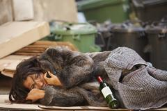 tramp woman lying - stock photo