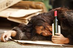 drunk tramp woman - stock photo
