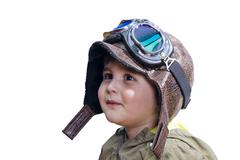 baby boy dreaming of becoming a pilot with an old style uniform and glasses - stock photo